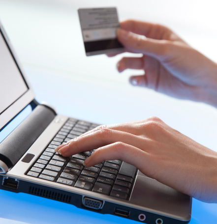image of a laptop and credit card