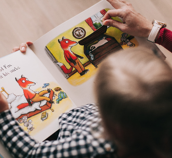 Child reading a picture book image
