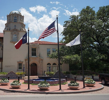 photo of Highland Park Town Hall and three flags