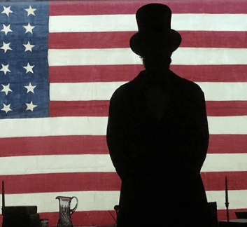 Silloutte of president Lincoln against the American Flag